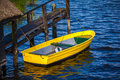 Yellow rowing boat at a jetty Royalty Free Stock Images