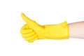 Yellow rubber glove of a cleaning lady arm show up Royalty Free Stock Photo
