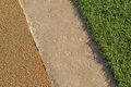Yellow Rubber Wetpour playground floor surface next to concrete and artificial grass. Royalty Free Stock Photo