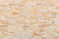 Yellow sandstone wall texture and background Royalty Free Stock Photo