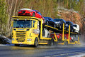Yellow Scania R500 Car Carrier Hauls New Vehicles Royalty Free Stock Photo