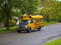 Yellow school bus on an empty street Stock Photo