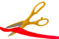 Yellow scissors and red ribbon Royalty Free Stock Photo