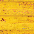 Yellow sea freight container background, rusty corrugated pattern, red primer coating, vertical rusted detailed steel texture Royalty Free Stock Photo