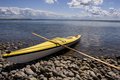 Yellow sea-kayak on beach Royalty Free Stock Image