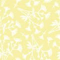 Yellow seamless pattern with small white bouquets.