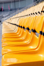 Yellow seat in stadium Stock Photo