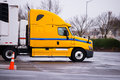 Yellow semi trucks reefer trailer on parking warehouse Royalty Free Stock Photo