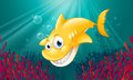 A yellow shark smiling under the sea illustration of Stock Image