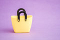 Yellow Small Decorative Plastic Bags with handle on Purple  Back Royalty Free Stock Photo
