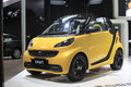 Yellow smart car showing in amoy city china in Stock Photo