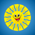 Yellow smiling sun on summer background Royalty Free Stock Photo