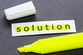 Yellow solution word on piece of paper with highlight pen Stock Photos