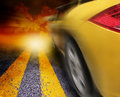 Yellow Sport Car Driving to Sunset Royalty Free Stock Photo