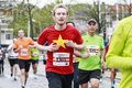 Yellow star dordrecht the netherlands april young athlete wearing red t shirt with running in the th edition of dwars door dordt a Royalty Free Stock Photography