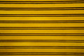 Yellow steel roller shutter door background ( garage door with h Royalty Free Stock Photo