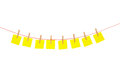 Yellow stickies hanged on red rope Stock Photo