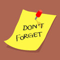 Yellow sticky note with dont forget message on boa Royalty Free Stock Photo
