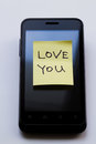 Yellow sticky note with  Love You. Royalty Free Stock Photo