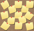 Yellow sticky notes on sand board.