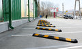Yellow striped bumps on parking space near construction with straped Royalty Free Stock Images