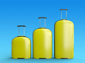 Yellow suitcases three travel with handles on a blue gradient background d rendered illustration Stock Photos