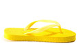 Yellow summer flip flop isolated on white background Stock Photography