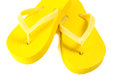 Yellow summer flip flop shoes isolated on white background Stock Photo