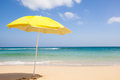 Yellow sunshade travel background with a blue sky turquoise sea and a beautiful beach fuerteventura canary islands spain europe Stock Photo