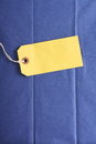 Yellow tag on blue blank paper luggage or gift a background of tissue wrapping paper Stock Image