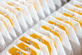 Yellow tagged teabags packed in a row Royalty Free Stock Photography