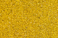 Yellow tarmac a used as a pavement at one of the kids playgrounds in a bucharest park romania Royalty Free Stock Images