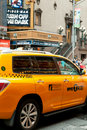 Yellow taxi cab on 42nd street in New York City Royalty Free Stock Photos