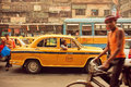 Yellow taxi car buses and cyclists driving on the busy street of indian city kolkata india jan january in calcutta kolkata has Royalty Free Stock Photo