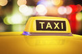 Yellow taxi sign on car macro view of in evening or night city street outdoors Royalty Free Stock Images