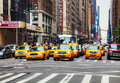 Yellow taxis at the new york city street may on may in cars serve as in nyc and are easy to spot among other Stock Photo