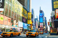 Yellow taxis at times square in new york city may with the tourists on may cars serve as nyc and are easy Royalty Free Stock Photo