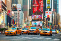 Yellow taxis at times square in new york city may with the tourists on may cars serve as nyc and are easy Stock Image