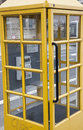 Yellow telephone booth in luxembourg Royalty Free Stock Photos