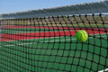 Yellow Tennis Ball Hitting the Net Stock Image