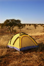 Yellow tent in the wilderness. Stock Photo