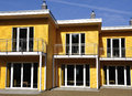 Yellow terraced house front view of a newly built waiting for its residents Royalty Free Stock Photo