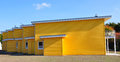 Yellow terraced house side view of a newly built waiting for its residents Royalty Free Stock Photography