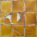 Yellow tile cracked Royalty Free Stock Photo