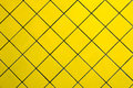 Yellow tile wall exterior building photographed close up Royalty Free Stock Photography
