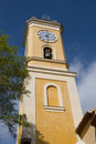 Yellow tower of catholic church in eze france Stock Images