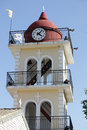 Yellow the town hall with clock in Moraitika. Corfu. Greece.