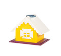 Yellow toy house model isolated on white background Stock Photos