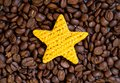 Yellow toy star and coffee beans