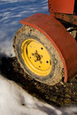 Yellow tractor wheel. Royalty Free Stock Image